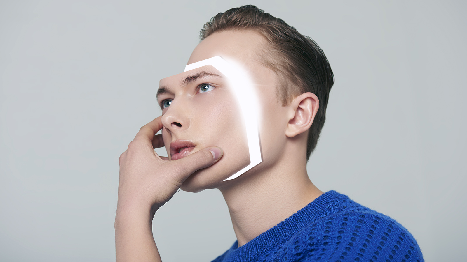 Android man removing his face